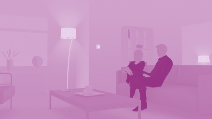 Visualization of a couple sitting on the couch at home enjoying LED lighting